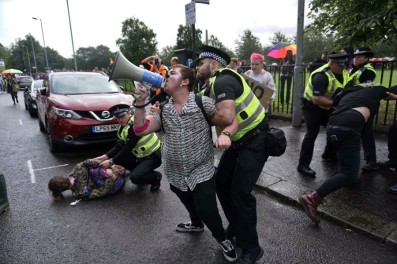 trans activists being rough-handled by police as they are arrested for demonstrating at Glasgow Pride